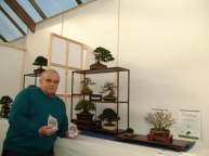 Stuart Norris with his awards in front of his composition.